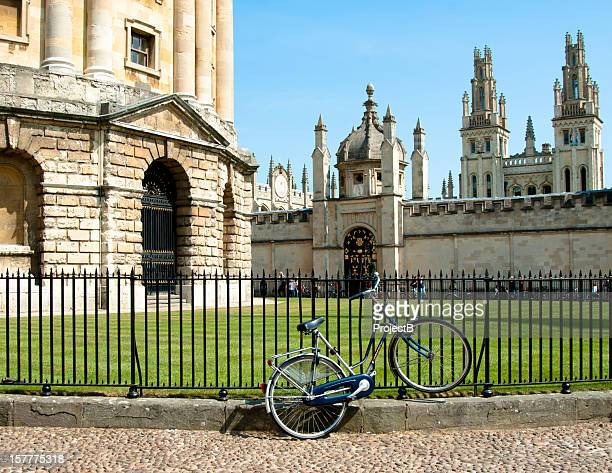 Bicycle tied to railings against bodleian radcliffe library in Oxford