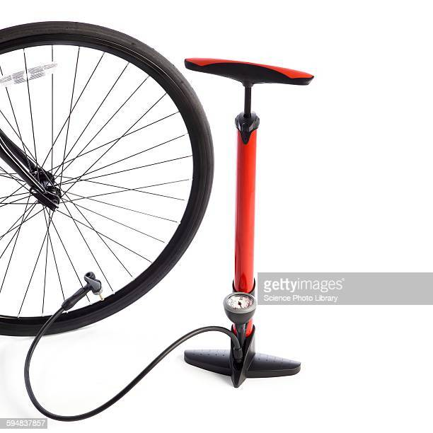 bicycle wheel and bicycle pump - air pump stock photos and pictures
