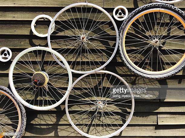 Bicycle Wheel Hanged To Wooden Wall