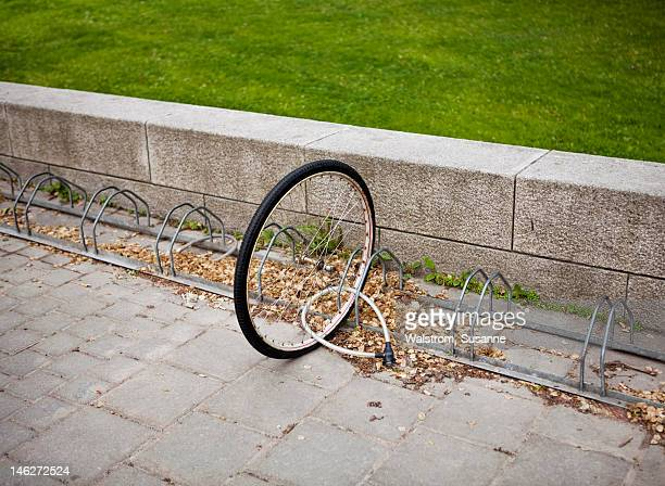 Bicycle wheel locked to bicycle stand
