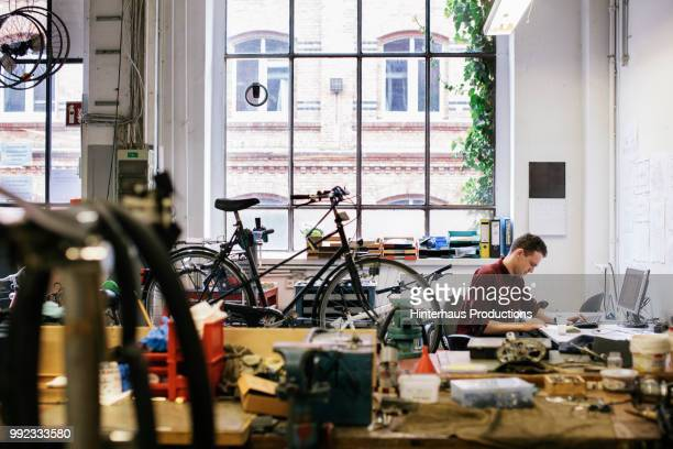 Bicycle Workshop Technician Doing Administrative Work