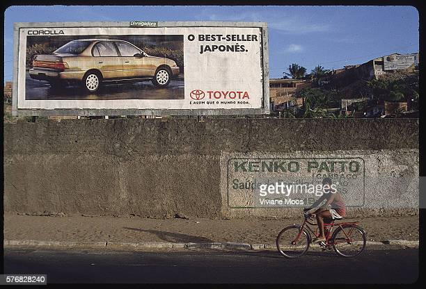 Bicycler Passing Large Billboards in Fortaleza Brazil