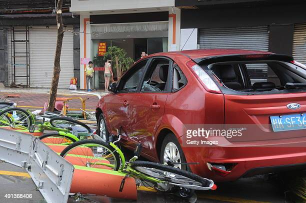 Bicycles and a car are sgiwb damaged by Typhoon Mujigae on October 4 2015 in Zhanjiang China Typhoon Mujigae the 22nd typhoon this year made landfall...