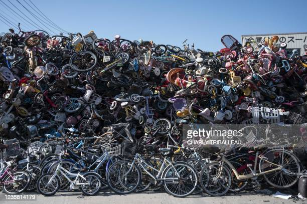 Bicycles and bicycle parts are pictured in a landfill in Saitama on October 11, 2021.