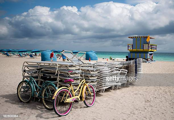 Bicycles and stacked up chairs sit on the sand in Miami Beach Florida US on Wednesday Feb 20 2013 US exports in the travel and tourism sector reached...