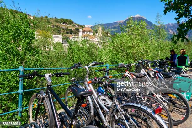 Bicycles are parked at the Etsch river in the green city centre of Meran in South Tyrol on April 21 2015 in Lana Italy