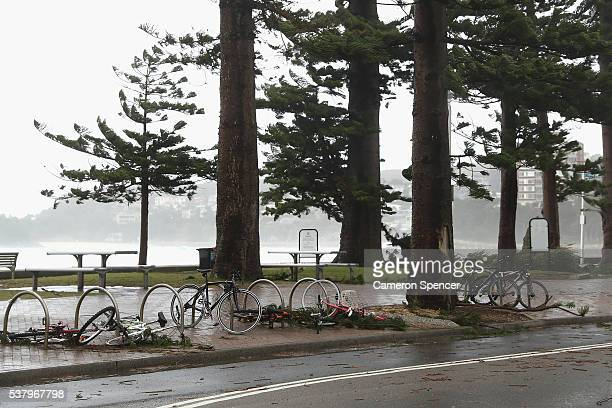 Bicycles are seen on the ground at Manly Beach on June 4 2016 in Sydney Australia The Bureau of Meteorology is forecasting up to 300mm of rain over...