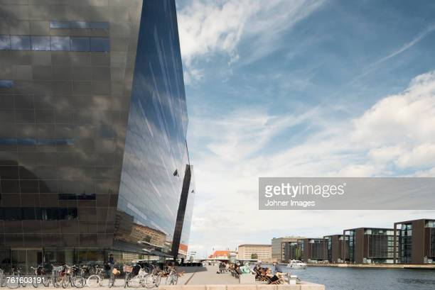 bicycles by modern building - copenhagen stock pictures, royalty-free photos & images
