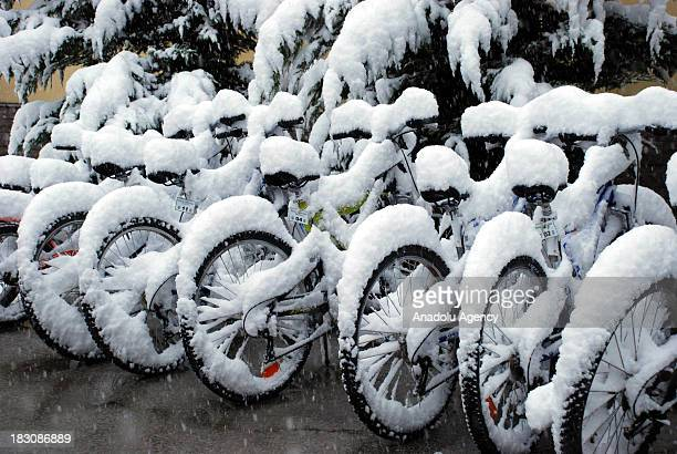 Bicycles covered in snow on October 4 2013 in Abant Nature Park Turkey The recent cold front sweeping across Turkey as a result of the low pressure...