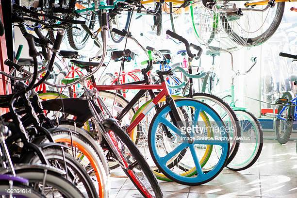 bicycles for sale in shop - bicycle shop stock pictures, royalty-free photos & images