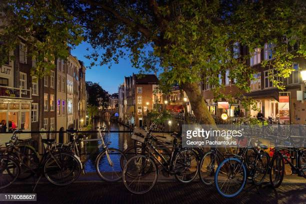 bicycles in a canal of utrecht, the netherlands - utrecht stock pictures, royalty-free photos & images