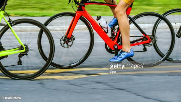 bicycles in motion - cycling event stock pictures, royalty-free photos & images