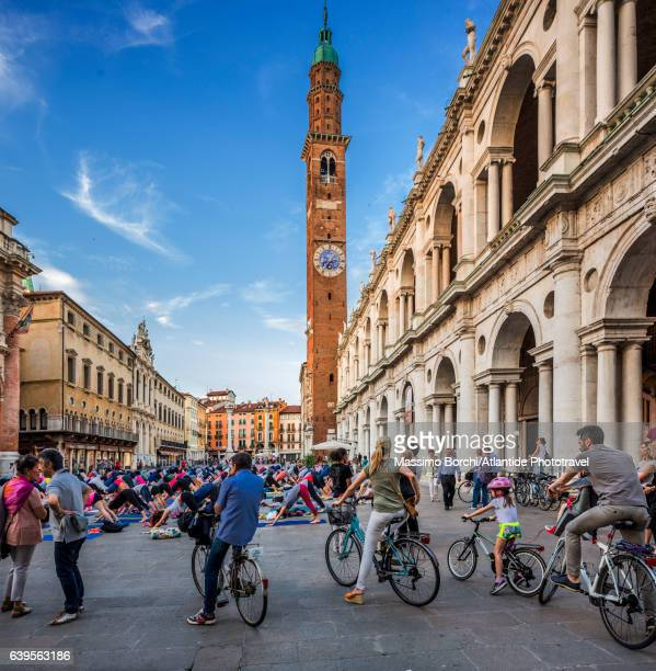 Bicycles in Piazza (square) dei Signori, the Basilica Palladiana (Palladio architect) on the right, the Torre (tower) Bissara on the background