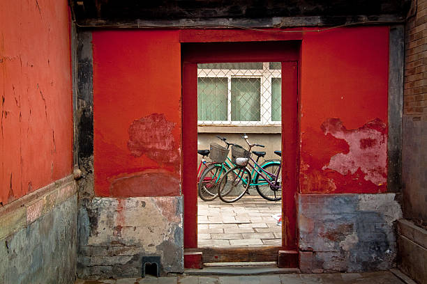 Bicycles in red doorway