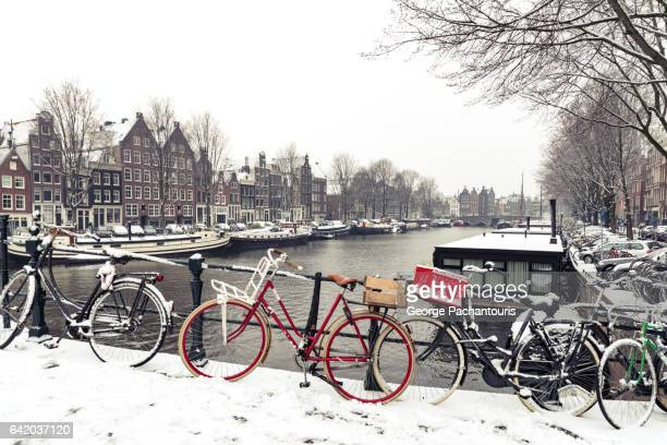 Bicycles in snow in Amsterdam, Netherlands