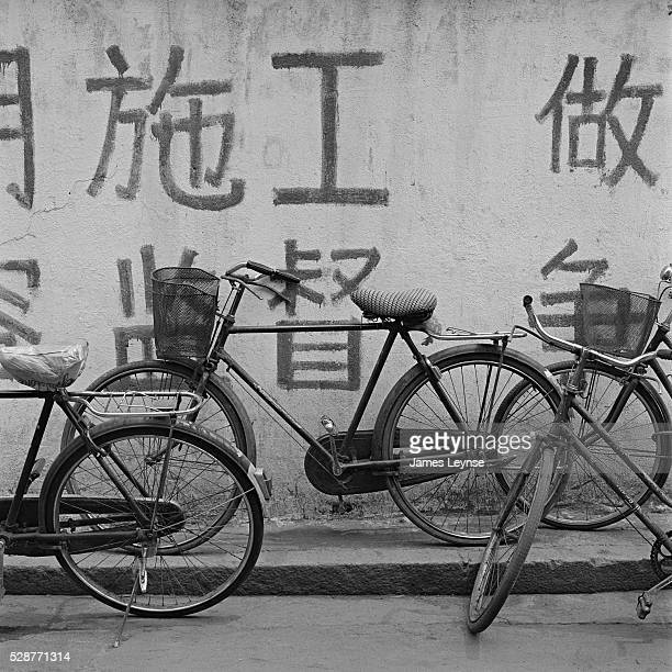 Bicycles leaning against a wall in Shanghai