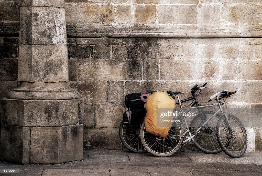 Bicycles leaning against walls : Stock Photo