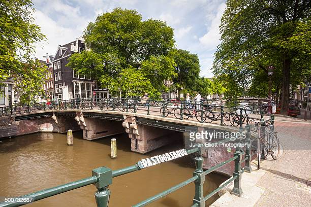 Bicycles line a canal bridge in Amsterdam