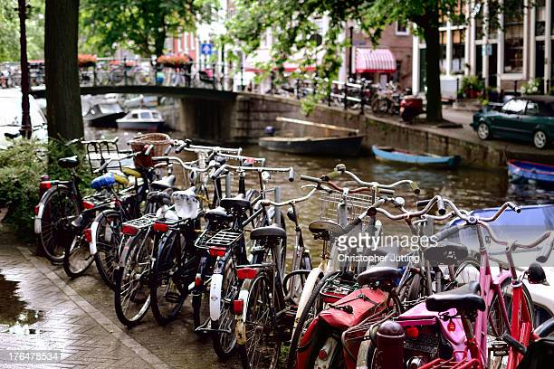 CONTENT] Bicycles lining one of the many canals arcing through Holland's capital Bicycles are a primary mode of transport for those wishing to travel...