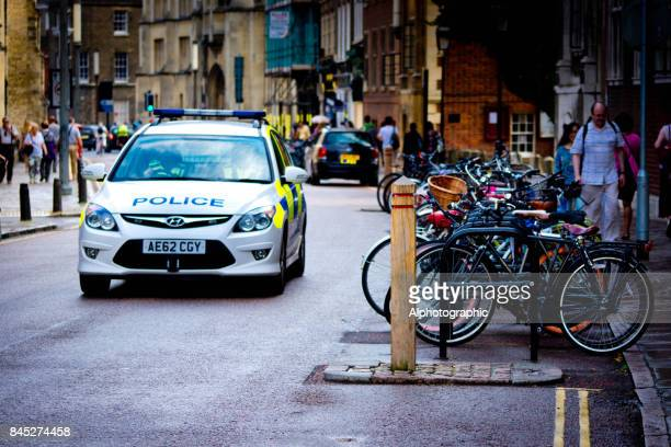 bicycles near river cam - police car stock photos and pictures