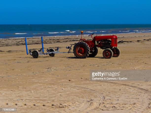 bicycles on beach against clear sky - arromanches stock pictures, royalty-free photos & images