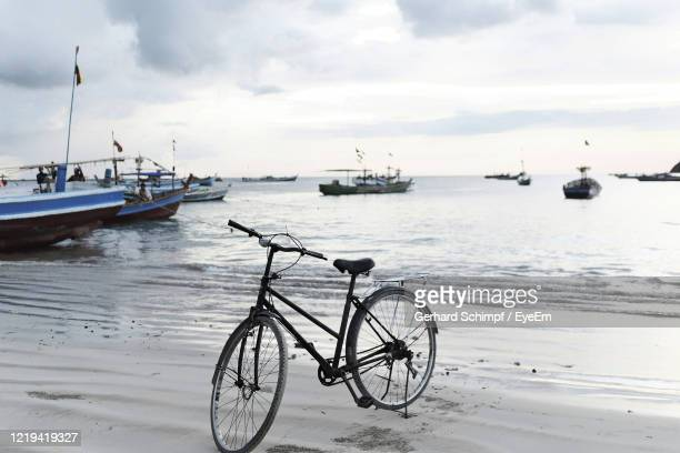 bicycles on beach against sky - gerhard schimpf stock pictures, royalty-free photos & images
