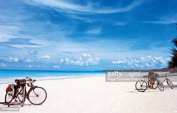 bicycles on the beach zanzibar - zanzibar island stock photos and pictures