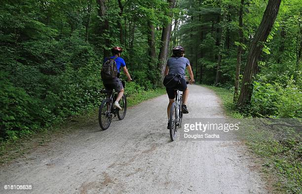bicycles on the towpath trail, cuyahoga valley national park, akron, ohio, usa - cuyahoga river stock photos and pictures