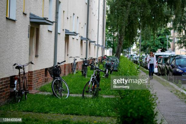 Bicycles outside residential apartment blocks on the Carl Legien modernist housing estate, operated by Deutsche Wohnen SE, in Berlin, Germany, on...