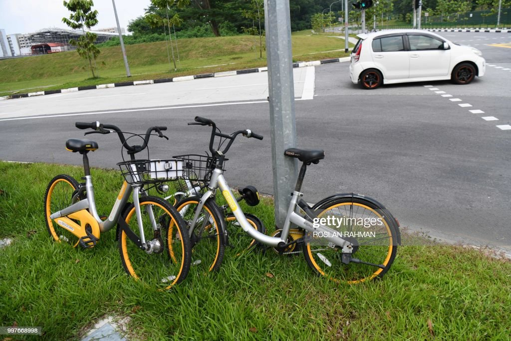 Bicycles Owned By Bike Sharing Company Obike Are Seen Park On A Roadside In Singapore
