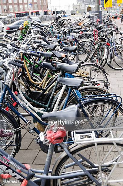 bicycles parked along the street - ogphoto stock pictures, royalty-free photos & images