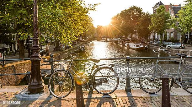 bicycles parked at bridge railing - malmo stock pictures, royalty-free photos & images