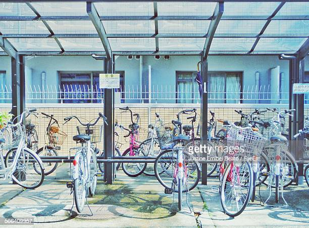 bicycles parked at parking lot - human powered vehicle fotografías e imágenes de stock