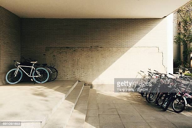 bicycles parked at parking lot - bicycle parking station stock photos and pictures