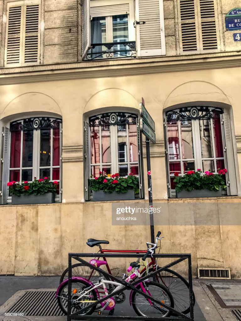 Bicycles parked near beautiful Paris building, France : Stock Photo