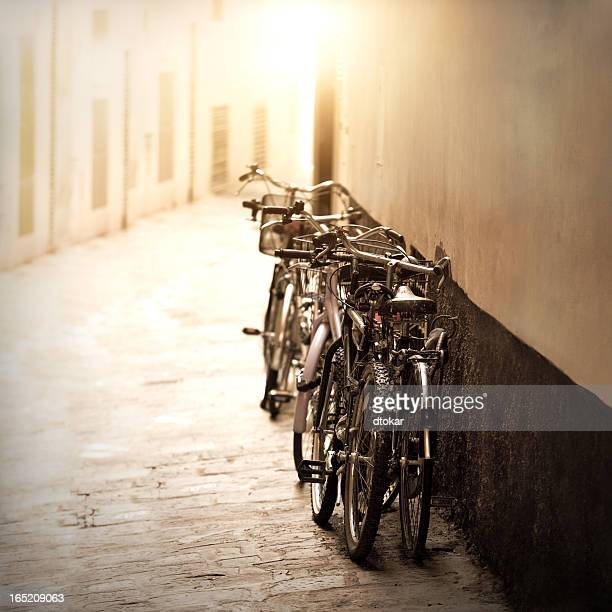 Bicycles parked near Italian wall in Florence