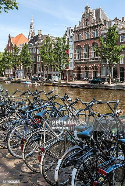 Bicycles parked on a gracht in the inner city of Amsterdam Netherlands