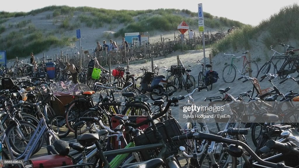Bicycles Parked On Beach Against Clear Sky : Stock Photo
