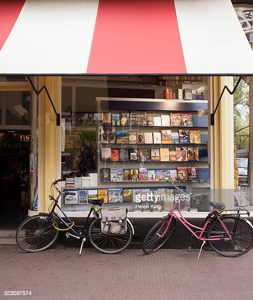 bicycles parked outside bookstore - book shop stock pictures, royalty-free photos & images