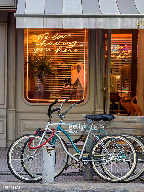 bicycles parked outside shop - palermo buenos aires stock photos and pictures