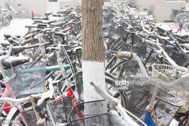 bicycles with snow - liyao xie stock pictures, royalty-free photos & images