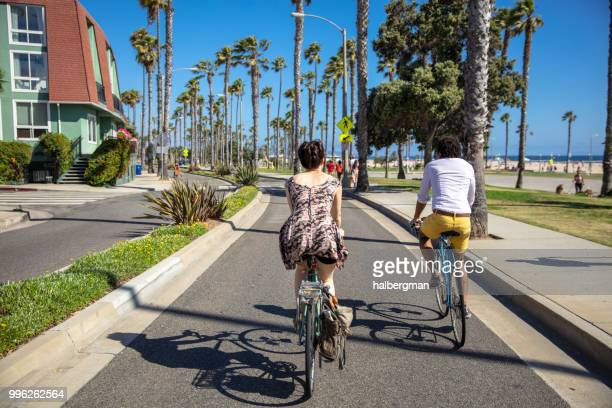 bicycling couple in santa monica, ca - santa monica stock pictures, royalty-free photos & images
