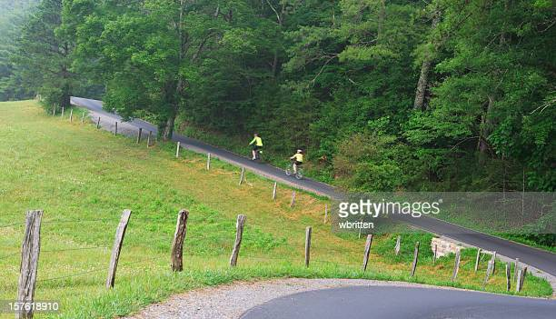 bicycling on a country road in the smoky  mountains - cades cove stock pictures, royalty-free photos & images