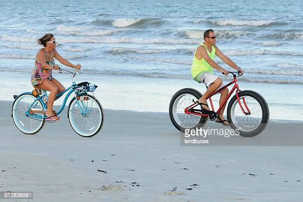 bicycling on the beach - cocoa beach stock pictures, royalty-free photos & images