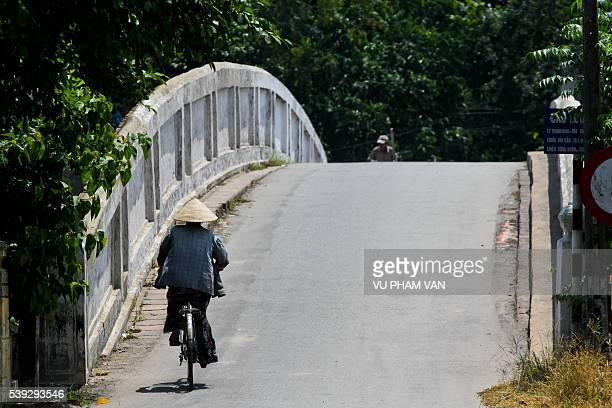 Bicycling over the bridge with copy space