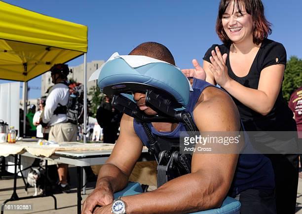 DENVER CO Bicyclist and preschool teacher Scott Poindexter gets a massage from Brandi Johnson at Civic Center Park after riding in the Denver Council...