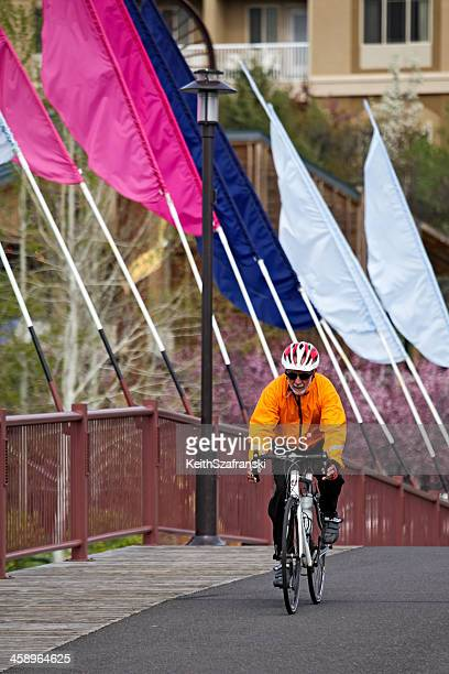 bicyclist in bend - bend oregon stock photos and pictures