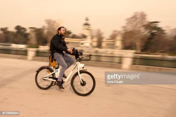Bicyclist in El Retiro Park