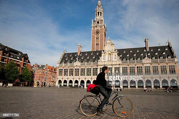 bicyclist in front of the old library - leuven stock pictures, royalty-free photos & images