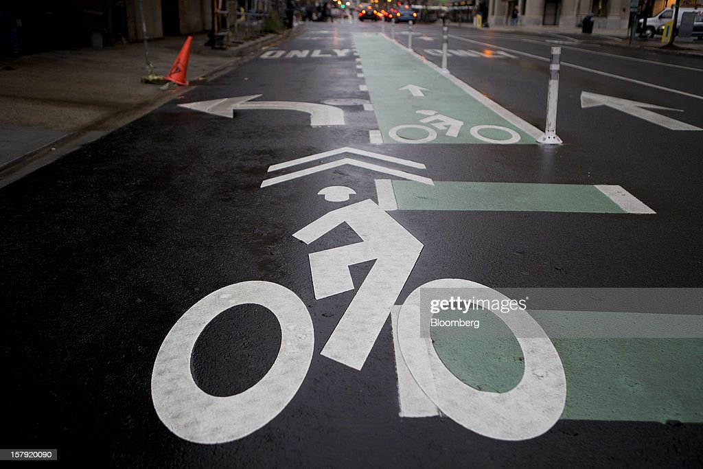 A bicyclist logo marks a bike lane in Washington, D.C., U.S., on Friday, Dec. 7, 2012. Since Sept. 2010, Capital Bikeshare has dispersed more than 1700 bikes for rent across the city and has totaled over 3.5 million rides since Sept. 2011. Alta Bicycle Share, the company that was awarded the contract to run the program, has installed 191 solar-powered docking stations throughout the District and Arlington, Virginia. Photographer: Andrew Harrer/Bloomberg via Getty Images